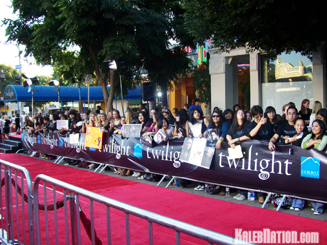 Peoples standing against the red carpet